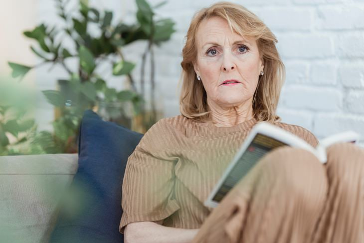 Stages of Parkinson's Disease sad woman reading