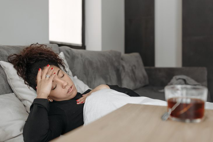 COVID-19 Side Effects and Immunity woman with a fever
