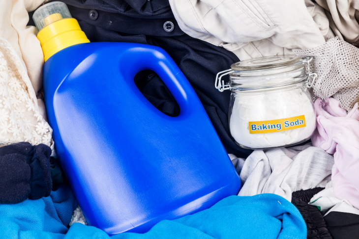 Baking Soda For Laundry detergent and baking soda in a pile of laundry