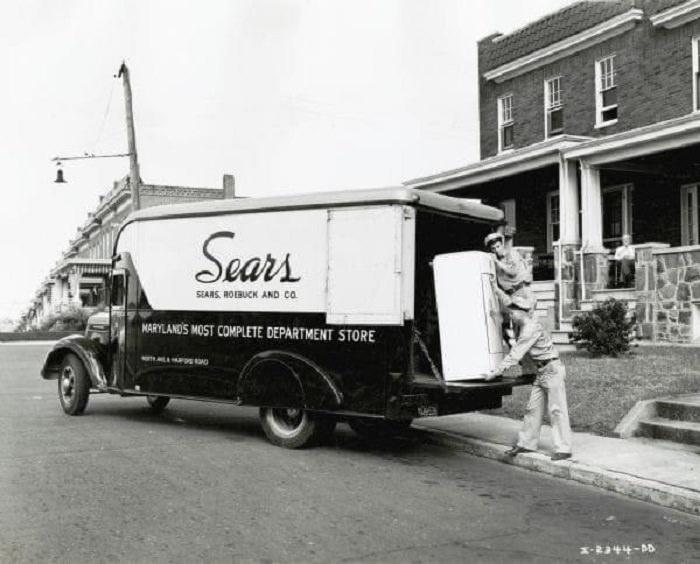 A Sears truck delivering a refrigirator, 1940