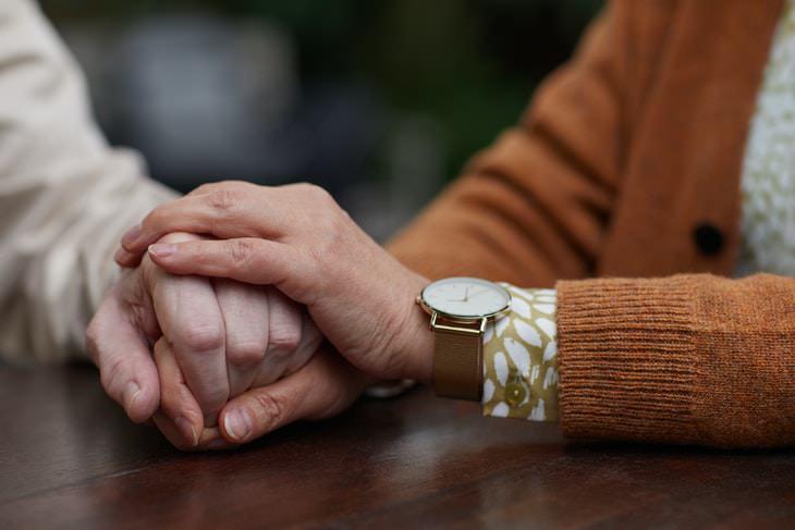 Parkinson's Medication holding hands