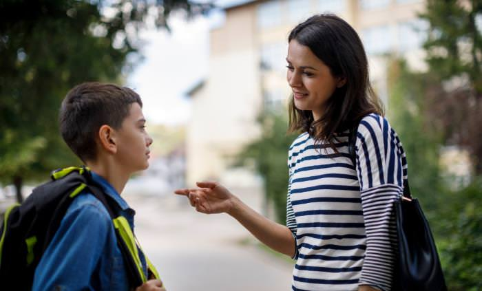 mother and son talking after school