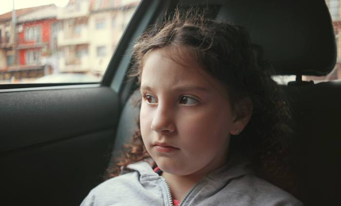 angry child in backseat