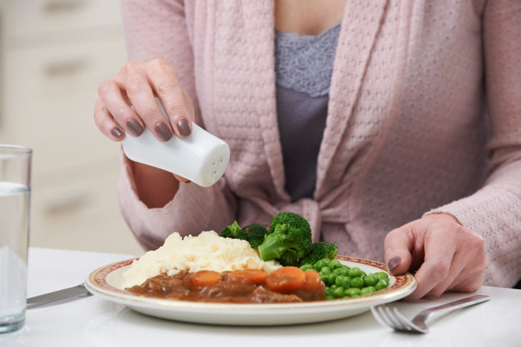 Salt Substitutes woman seasoning food