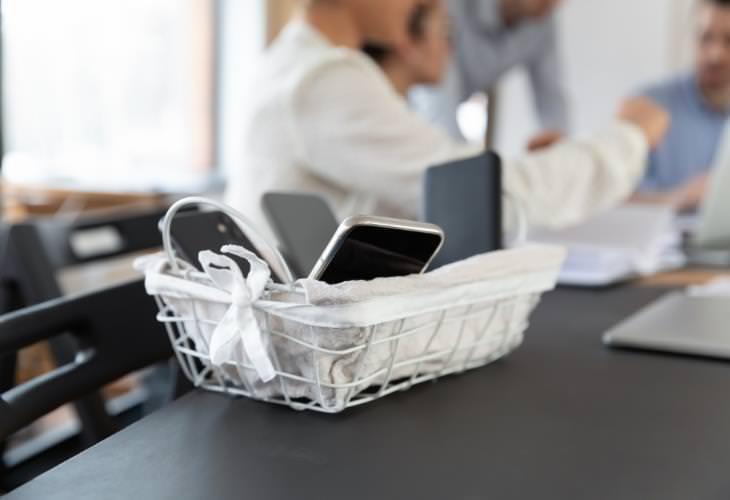 smartphones put away in basket