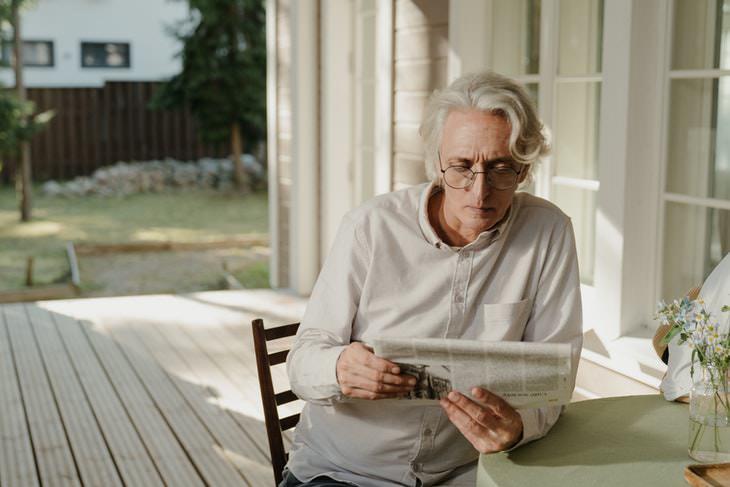 Gray Hair Causes man reading newspaper