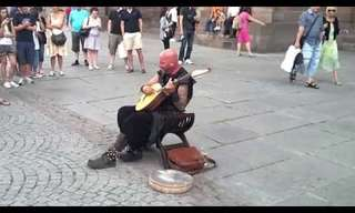 A Street Performer Sings in an Ancient Way...