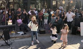 This Young Violinist Knows How to Get the Crowd Going